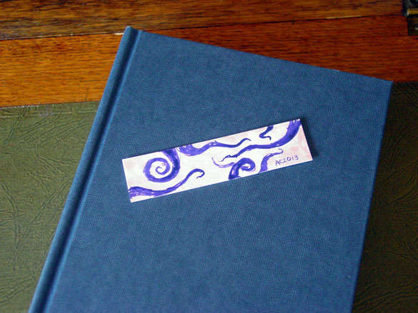 Tentacle Bookmark 5, with book, by Amy Crook